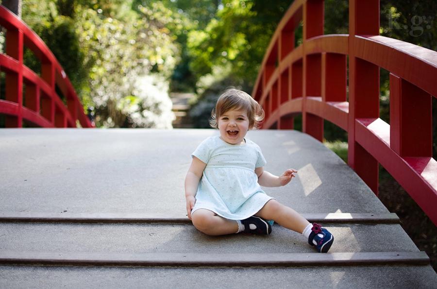 little girl playing on bridge