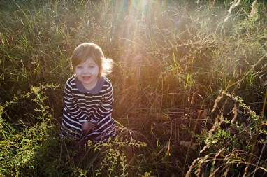 Toddler playing in field