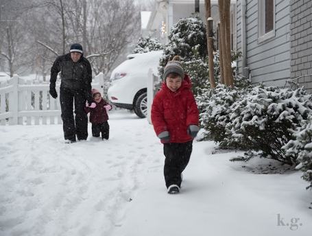 Family fun in the snowy yard