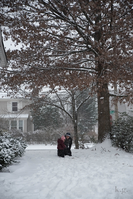 Dad and little girl in snow