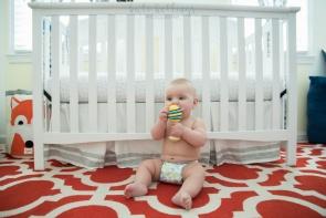 baby boy by his crib