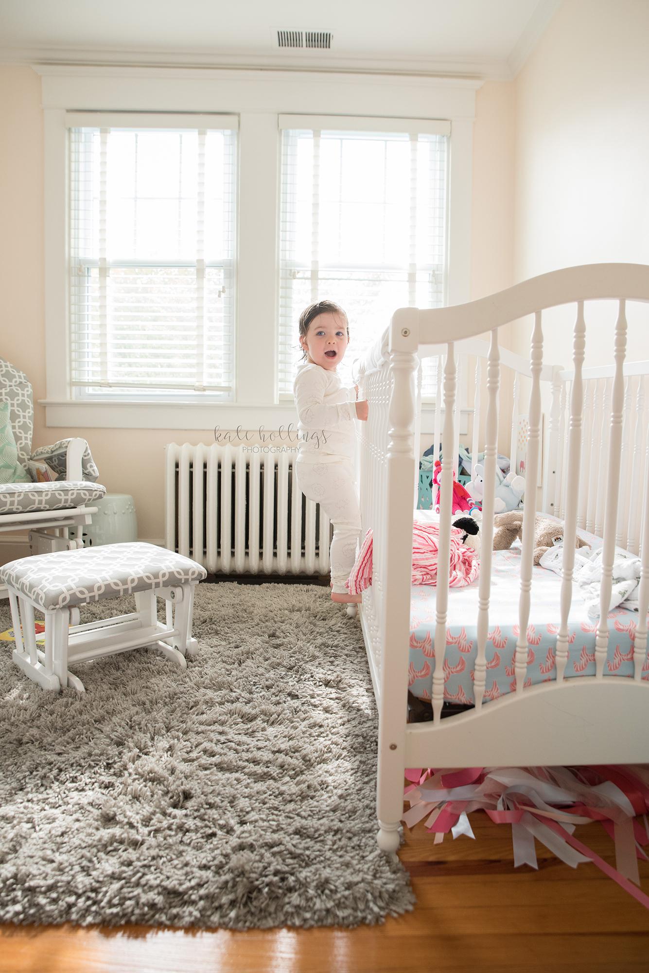E climbing her crib