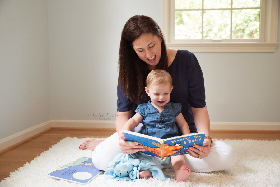 one year girl - reading with mama