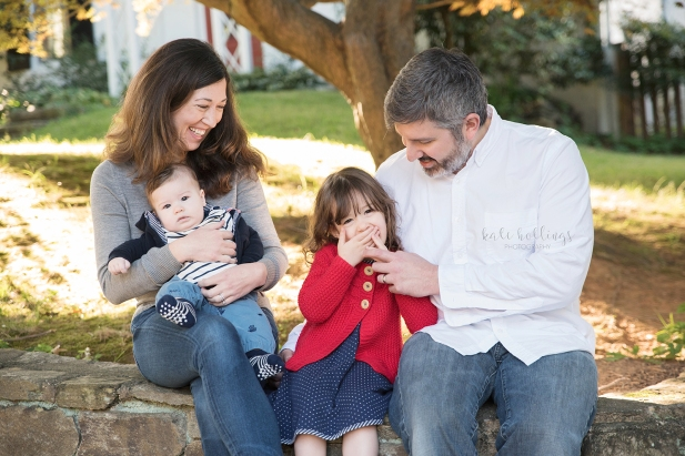 Family of four giggles