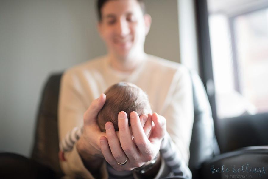 Newborn boy in daddy's hands