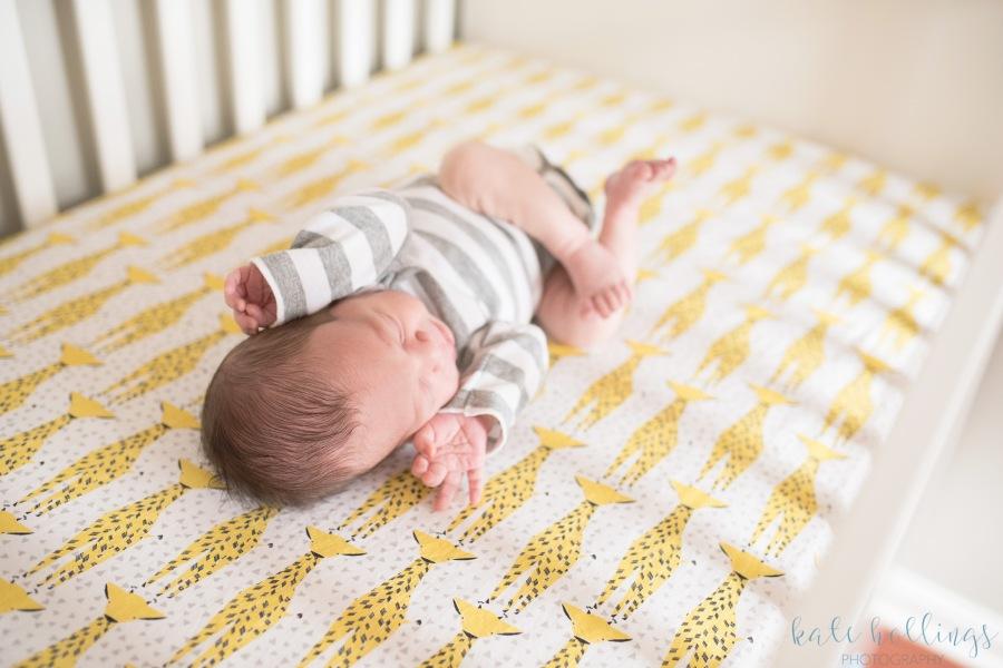 Newborn boy in crib